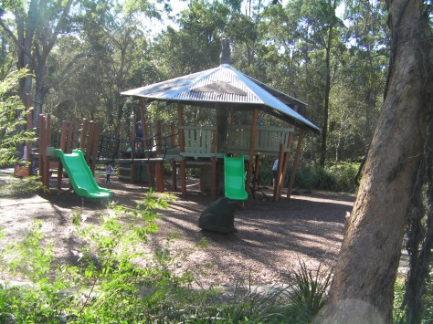 The shaded timber playground suits a variety of ages.